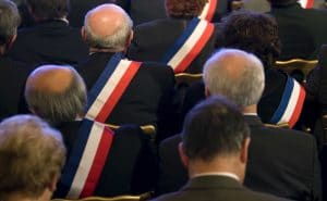 French Mayors, wearing their tri-colour scarves, listen to France's President Nicolas Sarkozy (not pictured) as he delivers a speech at the Elysee Palace in Paris , FRANCE-20/11/2009